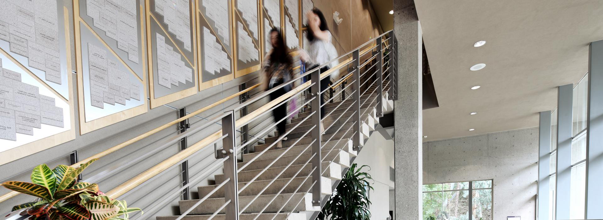 Students walking down library staircase