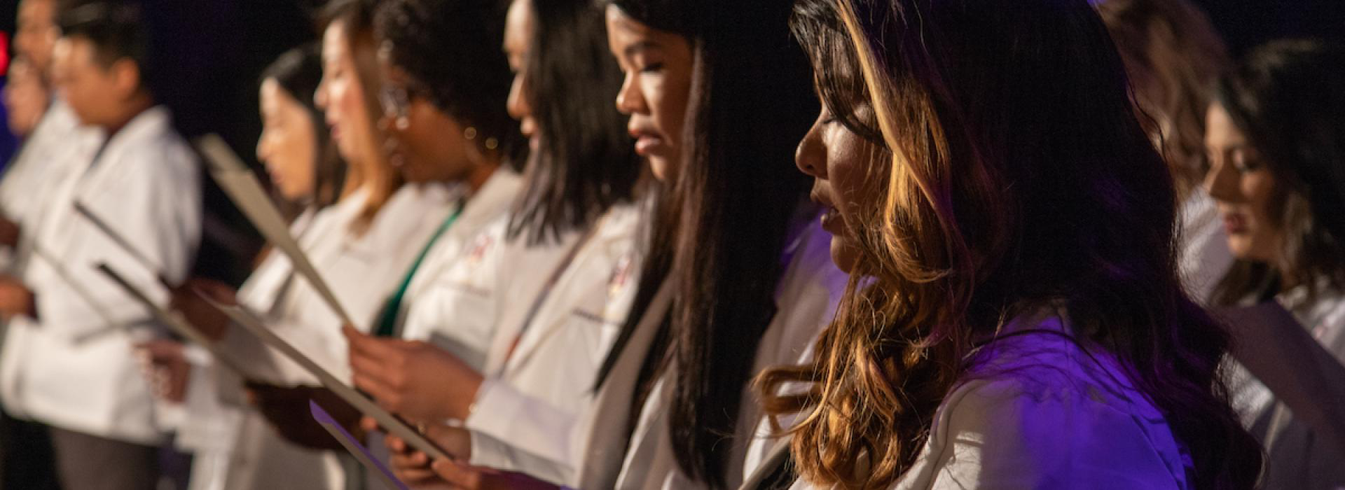 Students reading the Oath during white coat ceremony